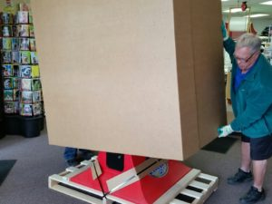 arcade game boxed on pallet
